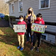 Kaitlyn Tierney gave MCCEA awards to Woodmont 3rd grader Snithik Selvakumar and Hilldale 2nd grader Aaryan Pulijala as poster contest winners.