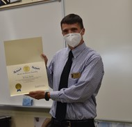 "Morris County Teacher of the Year Christopher Butchko with the Certificate of ""Commendations and Praise."""