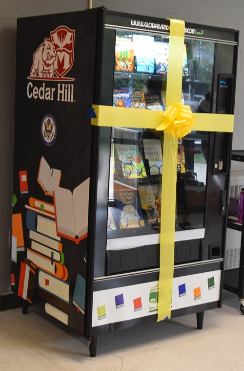 The Book Box Vending Machine is decorated with bright books.