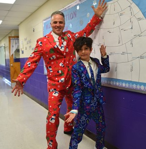 5th grade teacher Brian Quinn & 5th grader Saeed Pendleton wore holiday suits for the 15th annual Woodmont Elementary School GIVING DAY assembly.